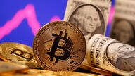FILE PHOTO: FILE PHOTO: FILE PHOTO: A representation of virtual currency Bitcoin and U.S. One Dollar banknotes are seen in front of a stock graph in this illustration