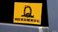 FILE PHOTO: A sticker that references the QAnon slogan is seen on a truck that participated in a caravan convoy in Adairsville