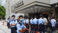 Police stand guard outside the High Court during court hearing of Tong Ying-kit, the first person charged under a new national security law, in Hong Kong