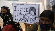 People protest against the alleged rape and murder of a 9-year-old girl, in New Delhi