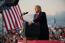 US President Donald Trump holds a Make America Great Again rally as he campaigns at Orlando Sanford International Airport in…