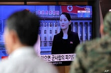 A man watches a TV screen showing a news program with a file image of Kim Yo Jong, the powerful sister of North Korea's leader…