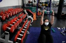 Mayra Miranda, 34, wears a mask while exercising at a gym in Los Angeles. Friday, June 26, 2020. With the coronavirus surging,…