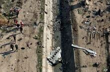 FILE - In this Jan. 8, 2020 file photo, rescue workers search the scene where a Ukrainian plane crashed in Shahedshahr,…