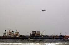 FILE - In this May 25, 2020 file photo, the Iranian oil tanker Fortune is anchored at the dock of El Palito refinery near…