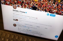 FILE - This June 27, 2019, file photo President Donald Trump's Twitter feed is photographed on an Apple iPad in New York. …