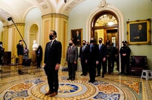 Democratic House impeachment managers stand after delivering the article of impeachment to the Senate alleging incitement of…