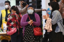 Relatives of passengers arrive at a crisis center set up following a report that a Sriwijaya Air passenger jet has lost contact…