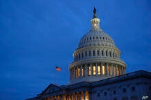 Light illuminates the U.S. Capitol dome on Capitol Hill in Washington, Monday, March 16, 2020. With an urgency unseen since the…
