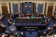 In this image from video, the final vote total of ۵۷-۴۳, to acquit former President Donald Trump of the impeachment charge,…