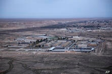 FILE  - This Dec. 29, 2019, aerial file photo taken from a helicopter shows Ain al-Asad air base in the western Anbar desert,…