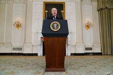 President Joe Biden delivers remarks about vaccinations, in the State Dining Room of the White House, Tuesday, April 6, 2021,…