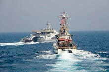 In an April 2, 2021, photo released by the U.S. Navy, an Iranian Revolutionary Guard vessel cut in front of the U.S. Coast…