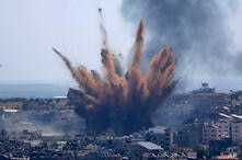 Smoke rises following Israeli airstrikes on a building in Gaza City, Thursday, May 13, 2021. Weary Palestinians are somberly…