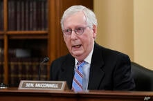 """Senate Minority Leader Mitch McConnell, R-Ky., speaks at a Senate Rules Committee markup to argue against the """"For the People…"""