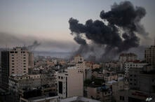 Smoke rises after Israeli airstrikes on Gaza City, Wednesday, May 12, 2021. Rockets streamed out of Gaza and Israel pounded the…