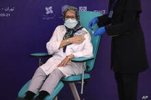 The supervisor of the Coviran Barekat Covid-19 vaccine research team, Dr. Monoo Mohraz, receives the vaccine during the third…
