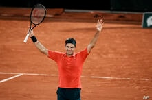 Switzerland's Roger Federer celebrates after defeating Germany's Dominik Koepfer in their third round match on day 7, of the…
