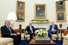 President Joe Biden, right, meets with Afghan President Ashraf Ghani, center, and Chairman of the High Council for National…