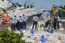 Rescue crews work at the site of the collapsed Champlain Towers South condo building after the remaining structure was…