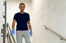 Russian opposition politician Alexei Navalny goes downstairs at Charite hospital in Berlin
