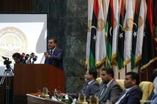 Libya's new Prime Minister Abdulhamid Dbeibeh speaks in parliament in Sirte