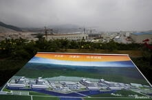 FILE PHOTO: An artist impression of Taishan Nuclear Power Plant is displayed on a viewing platform overlooking the construction site in Taishan, China