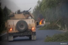 Humvees that belong to Afghan Special Forces are seen destroyed during heavy clashes with Taliban during the rescue mission of a police officer besieged at a check post, in Kandahar province
