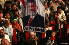 Morsi supporters are seen at a protest at Cairo's Rabaa al-Adawiya Square, the focal point of their sit-in, July 27, 2013.