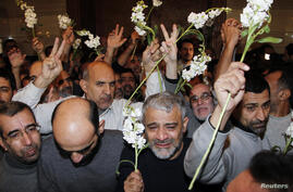 Iranians released by Syrian rebels arrive at a hotel in Damascus, Syria, January 9, 2013.