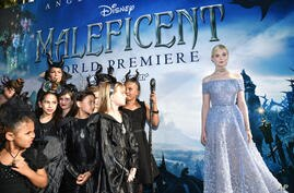 """Actress Elle Fanning arrives at the world premiere of """"Maleficent"""" at the El Capitan Theater in Los Angeles, California, May 28, 2014."""