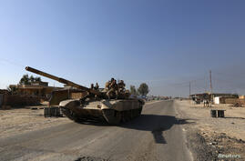 A tank of Iraqi security forces is seen in the town
