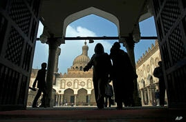 FILE - Muslims arrive to attend the Friday prayer at Al-Azhar mosque in Cairo, Egypt, Dec. 28, 2012.