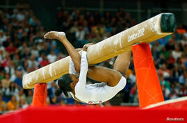 Gabrielle Douglas of the U.S. falls during the women's gymnastics balance beam final.