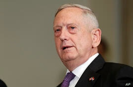 FILE - Defense Secretary Jim Mattis speaks at the Pentagon, Aug. 15, 2017.