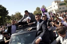 Iranian President Hassan Rouhani, center, waves to supporters upon his arrival from the U.S. near the Mehrabad airport in Tehran.