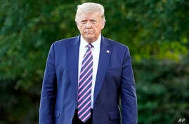 President Donald Trump walks from the Oval Office to speak to reporters on the South Lawn of the White House, Tuesday, Sept. 22…
