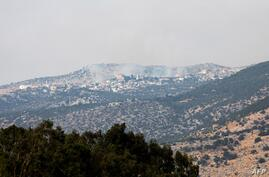 A picture taken from the Israeli side of the Blue Line that separates Israel and Lebanon shows smoke billowing above the Shebaa…
