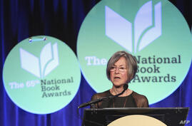 (FILES) This file photo taken on November 19, 2014 shows US author Louise Gluck giving a speech at the 2014 National Book…