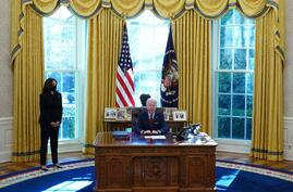 US President Joe Biden, with Vice President Kamala Harris (L), speaks before signing executive orders on health care, at the…