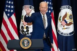 US President Joe Biden waves after speaking to the staff of the US State Department during his first visit in Washington, DC,…