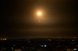 An explosion caused by Israeli Iron Dome air defense system missiles intercept rockets fired from Gaza Sunday, Feb. 23, 2020. …