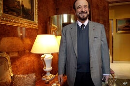FILE - In this Tuesday Nov. 15, 2011 file picture, Rifaat Assad poses for a photographer in Paris. Rifaat al-Assad, the uncle…