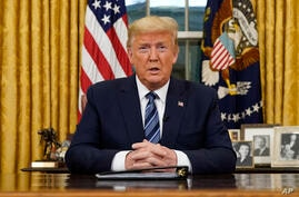 President Donald Trump speaks in an address to the nation from the Oval Office at the White House about the coronavirus…