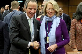 Elected Director General of the International Atomic Energy Agency (IAEA), Rafael Mariano Grossi from Argentina, left, shakes…