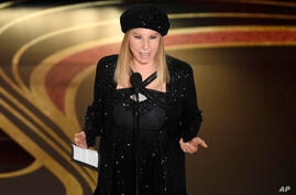 """FILE - In this Feb. 24, 2019 file photo, Barbra Streisand introduces """"BlacKkKlansman"""" at the Oscars at the Dolby Theatre in Los…"""