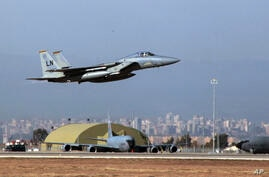 FILE- In this Dec. 15, 2015, file photo, A U. S. Air Force F-15 fighter jet takes off from Incirlik Air Base near Adana, Turkey…