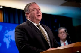 FILE - In this June 10, 2020, file photo, U.S. Secretary of State Mike Pompeo speaks during a news conference at the State…