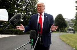 President Donald Trump speaks to members of the media on the South Lawn of the White House in Washington, Friday, July 10, 2020…