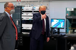 President Donald Trump gestures as he participates in a tour of Bioprocess Innovation Center at Fujifilm Diosynth…